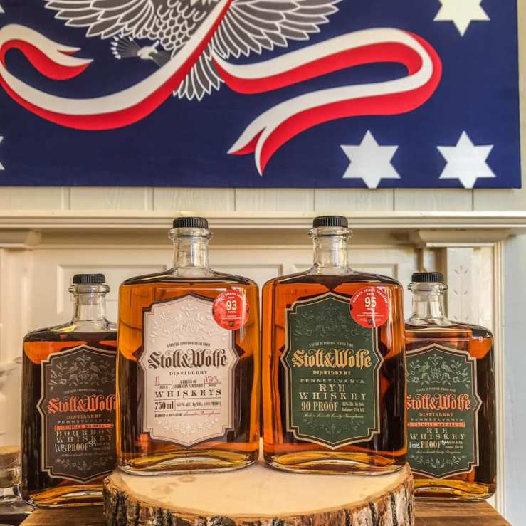 Stoll and Wolfe Rye Whiskey and Stoll and Wolfe Bourbon Whiskey bottles on display at the Whiskey Rebellion Festival.